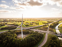 Aerial view of wind turbine spinning during beautiful day, Deventer, Netherlands.