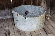 """There's a hole in my bucket dear Liza, dear Liza"" is a traditional childrens song, reminiscent of this image from Bodie -- California's official state gold rush ghost town. The above song is based on a humorous deadlock dialogue between Henry and Liza concerning a leaky bucket. Liza tells Henry to repair the leaky bucket; but to fix the leaky bucket, he needs straw. To cut the straw, he needs a knife. To sharpen the knife, he needs to wet the sharpening stone. To wet the stone, he needs water. However, when Henry asks how to get the water, Liza says ""in a bucket."" In a stalemate, Henry repeats ""there's a hole in my bucket dear Liza, dear Liza"". Bodie State Historic Park lies in the Bodie Hills east of the Sierra Nevada mountain range in Mono County, near Bridgeport, California, USA."