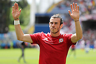 Gareth Bale of Wales waves to the Wales fans during prematch warm up. UEFA Euro 2016, group B , England v Wales at Stade Bollaert -Delelis  in Lens, France on Thursday 16th June 2016, pic by  Andrew Orchard, Andrew Orchard sports photography.