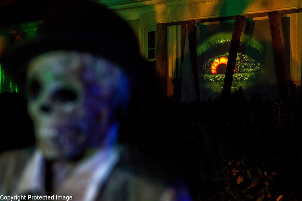 """An eye moves around in the window of Chris Baker's house in South Yarmouth, MA. Every year Baker sets up an elaborate Halloween display in his yard and on Halloween, neighborohood residents walk through his frightening """"vortex"""" of horror while trick or treating."""