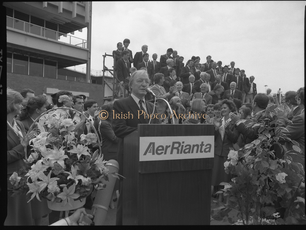 Irish Soccer Team Welcomed Home.   (R81)..1988..19.06.1988..06.19.1988..19th June 1988..After their great success in Germany in Euro 88, the Irish soccer team had a triumphant homecoming. An Taoiseach, Charles Haughey TD and his government were to the forefront of the welcome. Thousands of fans thronged the airport and all the approach roads in the hope of seeing the team. The full squad is as follows..1.GK.Packie Bonner. Celtic.2.DF.Chris Morris. Celtic.3.DF.Chris Hughton  Tottenham Hotspur.4.DF.Mick McCarthy. Celtic.5.DF.Kevin Moran. Manchester United.6.MF.Ronnie Whelan. Liverpool.7.MF.Paul McGrath. Manchester United.8.MF.Ray Houghton. Liverpool.9.FW.John Aldridge. Liverpool.10.FW.Frank Stapleton Derby County.11.MF.Tony Galvin. Sheffield Wednesday.12.FW.Tony Cascarino. Millwall.13.MF.Liam O'Brien. Manchester United.14.FW.David Kelly. Walsall.15.MF.Kevin Sheedy. Everton.16.GK.Gerry Peyton. Bournemouth.17.FW.John Byrne. Le Havre.18.FW.John Sheridan. Leeds United.19.DF.John Anderson. Newcastle United.20.FW.Niall Quinn. Arsenal..Image shows the  An Taoiseach,Charles Haughey TD, making the speech welcoming the squad back home. Manager Jack Charlton and his assistant Maurice Setters are pictured with the team in the background.
