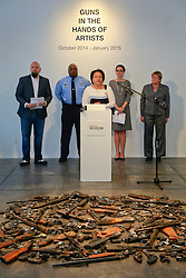 16 April 2014. Jonathan Ferrara Gallery, New Orleans, Louisiana. <br /> L/R; Jonathan Ferrara, Officer Earl Johnson and council members LaToya Cantrell,   Stacy Head and Susan Guidry at the Jonathan Ferrara Gallery to announce the 'Guns In The Hands Of Artists' project where artists take parts from 190 destroyed weapons acquired by the New Orleans Police department through a buy-back program and convert them into art.  <br /> Photo; Charlie Varley/varleypix.com