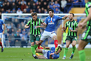 Dannie Bulman of AFC Wimbledon, Danny Hollands, battle during the Sky Bet League 2 match between Portsmouth and AFC Wimbledon at Fratton Park, Portsmouth, England on 15 November 2015. Photo by Stuart Butcher.