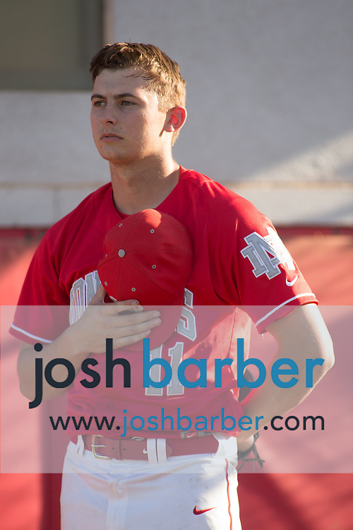 Mater Dei's Charlie Nies (11) during the national anthem during a Trinity League game at Mater Dei High School on Friday, May 1, 2015 in Santa Ana, Calif. (Photo/Josh Barber)