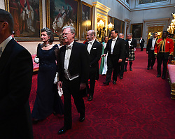 The Viscountess Brookeborough and John R. Bolton arrive through the East Gallery during the State Banquet at Buckingham Palace, London, on day one of the US President's three day state visit to the UK.