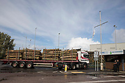 A truck carrying large tree trunks arrives at the Kent Renewable Energy Biomass CHP site in Discovery Park on 4th October 2021 in Sandwich, United Kingdom. The biomass-powered combined-heat-and-power CHP plant was opened in October 2018 and is said to be predominantly fuelled from wood supplied by EuroForest from local traditionally-managed coppiced woodlands.