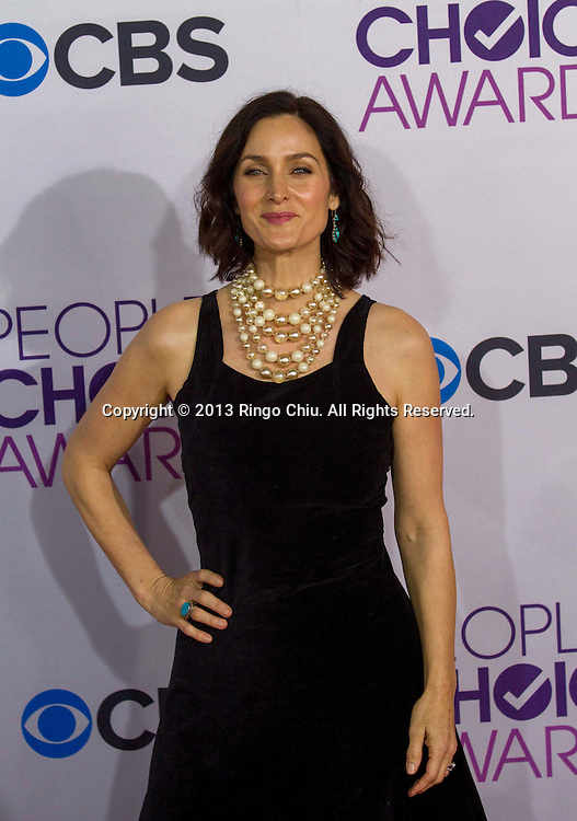 Carrie Anne Moss arrives at the 39th Annual People's Choice Awards at Nokia Theatre L.A. Live on Wednesday January 9, 2013 in Los Angeles, California, United States. (Photo by Ringo Chiu/PHOTOFORMULA.com)