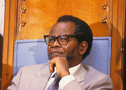 Jan. 27, 1987 - Washington, District of Columbia, United States of America - Washington DC. 1-27-1987.Oliver Tambo President of the African National Congress waits to deliver his speech at Georgetown University..Oliver Tambo was born on 27 October 1917, his father was Mzimeni and his mother was called Julia. He was born in the village of Nkantolo in Bizana in eastern Pondoland in what is now Eastern Cape. He went to school at Holy Cross Mission School, and then transferred to St. Peters in Johannesburg. After matriculation he qualified to do his university degree at Fort Hare University. In 1940 he, along with several others including Nelson Mandela, was expelled from Fort Hare University for participating in a student strike. In 1942 Tambo returned to his former high school in Johannesburg to teach science and mathematics.Tambo, along with Mandela and Walter Sisulu, was a founding member of the ANC Youth League in 1943, becoming its first National Secretary and later a member of the National Executive in 1948. The youth league proposed a change in tactics in the anti-apartheid movement. Previously the ANC had sought to further its cause by actions such as petitions and demonstrations; the Youth League felt these actions were insufficient to achieve the group's goals and proposed their own 'Programme of Action'. This programme advocated tactics such as boycotts, civil disobedience, strikes and non-collaboration..Tambo being greeted on arrival in East Germany (1978).In 1955, Tambo became Secretary General of the ANC after Walter Sisulu was banned by the South African government under the Suppression of Communism Act. In 1958 he became Deputy President of the ANC and in 1959 was served with a five-year banning order by the government..In response, Tambo was sent abroad by the ANC to mobilise opposition to apartheid. He settled with his family in Muswell Hill, north London, where he lived until 1990. He was involved in the formation of the South African Democratic Fron