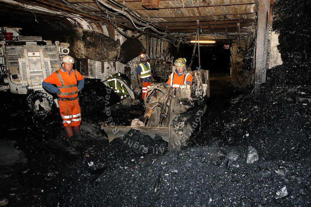 Miners at Unity Mine are extracting the first coal dug from the mine since its reopening more than a year ago, on Tuesday, July 31, 2007, in Cwmgwrach, Vale of Neath, South Wales. The time is ripe again for an unexpected revival of the coal industry in the Vale of Neath due to the increasing prize and diminishing reserves of oil and gas, the uncertainties of renewable energy sources, and the technological advancement in producing energy from coal while limiting emissions of pollutants, has created the basis for valuable investment opportunities and a possible alternative to the latest energy crisis. Unity Mine, in particular, has started a pioneering effort to revive the coal industry in the area, reopening after more than 8 years with the intent of exploiting the large resources still buried underground. Coal could be then answer to both, access to cheaper and paradoxically greener energy and a better and safer choice than nuclear energy as a major supply for the decades to come. It is estimated that coal reserves in Wales amount to over 250 million tonnes, or the equivalent of at least 50 years of energy supply, while the worldwide total coal could last for over 200 years as a viable resource compared to only a few decades of oil and natural gas.