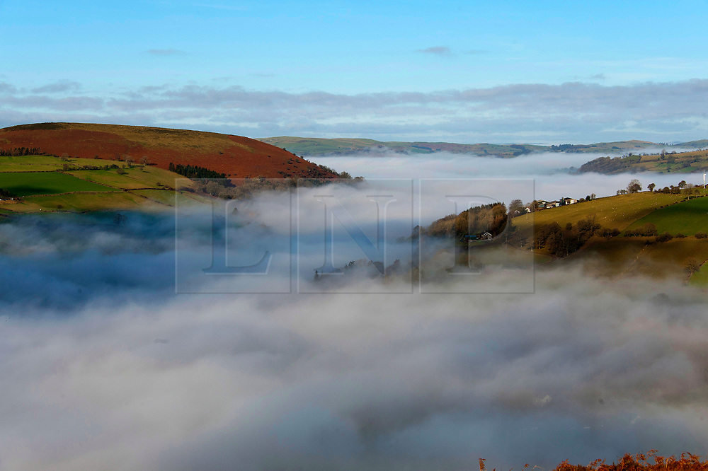 © Licensed to London News Pictures. 20/01/2020. Hundred House, Powys, Wales, UK. A sea of cloud forms in the valleys near Hundred House in Powys, Wales, UK. Temperatures dropped to minus 4C last night and fog hung in the valleys until early afternoon in Powys, Wales, UK. Photo credit: Graham M. Lawrence/LNP