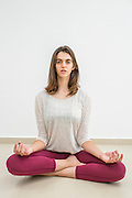 Young woman meditating indoors Model release available