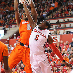 Syracuse Orange forward C.J. Fair (5) lays a basket in over Rutgers Scarlet Knights guard Eli Carter (5) during first half NCAA Big East basketball action between #2 Syracuse and Rutgers at the Louis Brown Athletic Center. Syracuse leads 40-34 at halftime.