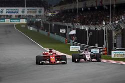 October 1, 2017 - Sepang, Malaysia - Motorsports: FIA Formula One World Championship 2017, Grand Prix of Malaysia, ..#5 Sebastian Vettel (GER, Scuderia Ferrari), #11 Sergio Perez (MEX, Sahara Force India F1 Team) (Credit Image: © Hoch Zwei via ZUMA Wire)