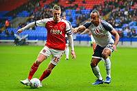 Fleetwood Town's Paul Coutts competes with Bolton Wanderers' Chris O'Grady<br /> <br /> Photographer Richard Martin-Roberts/CameraSport<br /> <br /> The EFL Sky Bet League One - Bolton Wanderers v Fleetwood Town - Saturday 2nd November 2019 - University of Bolton Stadium - Bolton<br /> <br /> World Copyright © 2019 CameraSport. All rights reserved. 43 Linden Ave. Countesthorpe. Leicester. England. LE8 5PG - Tel: +44 (0) 116 277 4147 - admin@camerasport.com - www.camerasport.com