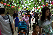 Visitors on the way to the Seokguram Buddha Grotto close to the city of Gyeongju. The Seokguram Grotto is a hermitage and part of the Bulguksa  temple complex. It lies four kilometers east of the temple on Mt. Tohamsan, in Gyeongju, South Korea. It is classified as Nationa Treasure No. 24 by the South Korean government and is located at 994, Jinhyeon-dong, Gyeongju-si, Gyeongsanbuk-do. / Gyeongju, South Korea, Republic of Korea, KOR, 21st of May 2010.