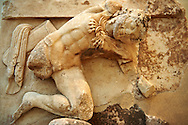 Hercules from the metope of hte Treasury of the Athenians, Delphi Archaeological Museum .<br /> <br /> If you prefer to buy from our ALAMY STOCK LIBRARY page at https://www.alamy.com/portfolio/paul-williams-funkystock/greco-roman-sculptures.html . Type -    Delphi     - into LOWER SEARCH WITHIN GALLERY box - Refine search by adding a subject, place, background colour, museum etc.<br /> <br /> Visit our ANCIENT GREEKS PHOTO COLLECTIONS for more photos to download or buy as wall art prints https://funkystock.photoshelter.com/gallery-collection/Ancient-Greeks-Art-Artefacts-Antiquities-Historic-Sites/C00004CnMmq_Xllw