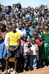 © Licensed to London News Pictures. 02/02/2014. Iten, Kenya. Running in Africa feature. People attend the opening of the first ever tartan track in Iten. Photo credit : Mike King/LNP