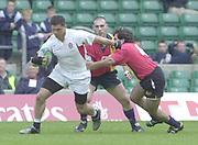 24/05/2002<br /> Sport - Rugby Union<br /> IRB World Sevens Series - Twickenham<br /> England v Spain<br /> Henry Paul hands off Pablo Feuoo  as he sets up an England attack.<br />    [Mandatory Credit, Peter Spurier/ Intersport Images]<br />    [Mandatory Credit, Peter Spurier/ Intersport Images]