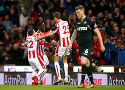 """Stoke City's Mame Biram Diouf celebrates scoring his side's second goal of the game during the Premier League match at the Bet35 Stadium, Stoke. PRESS ASSOCIATION Photo Picture date: Saturday December 2, 2017. See PA story SOCCER Stoke. Photo credit should read: Dave Thompson/PA Wire. RESTRICTIONS: EDITORIAL USE ONLY No use with unauthorised audio, video, data, fixture lists, club/league logos or """"live"""" services. Online in-match use limited to 75 images, no video emulation. No use in betting, games or single club/league/player publications"""
