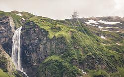 THEMENBILD - ein großer Wasserfall ergießt sich hinter dem Hintersee, ein Strommasten tront hoch oben auf dem Berg, aufgenommen am 23. Juni 2019, am Hintersee in Mittersill, Österreich // a large waterfall pours out behind the Hintersee, a power pylon tront high up on the mountain on 2019/06/23, Hintersee in Mittersill, Austria. EXPA Pictures © 2019, PhotoCredit: EXPA/ Stefanie Oberhauser