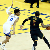 12 June 2017: Cleveland Cavaliers guard Kyrie Irving (2) drives past Golden State Warriors guard Patrick McCaw (0) during the Golden State Warriors 129-120 victory over the Cleveland Cavaliers, in game 5 of the 2017 NBA Finals, at the Oracle Arena, Oakland, California, USA.