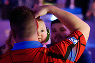 CUTENESS OVERLOAD Daryl Gurney and baby boy after his Second Round victory against Ross Smith during the Darts World Championship 2018 at Alexandra Palace, London, United Kingdom on 18 December 2018.