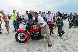 Vinnie Grasser pushing his 1930 Harley Davidson VL on the sands of Daytona Beach for the official start and stage Stage 1 of the Motorcycle Cannonball Cross-Country Endurance Run, which on this day ran from Daytona Beach to Lake City, FL., USA. Friday, September 5, 2014.  Photography ©2014 Michael Lichter.