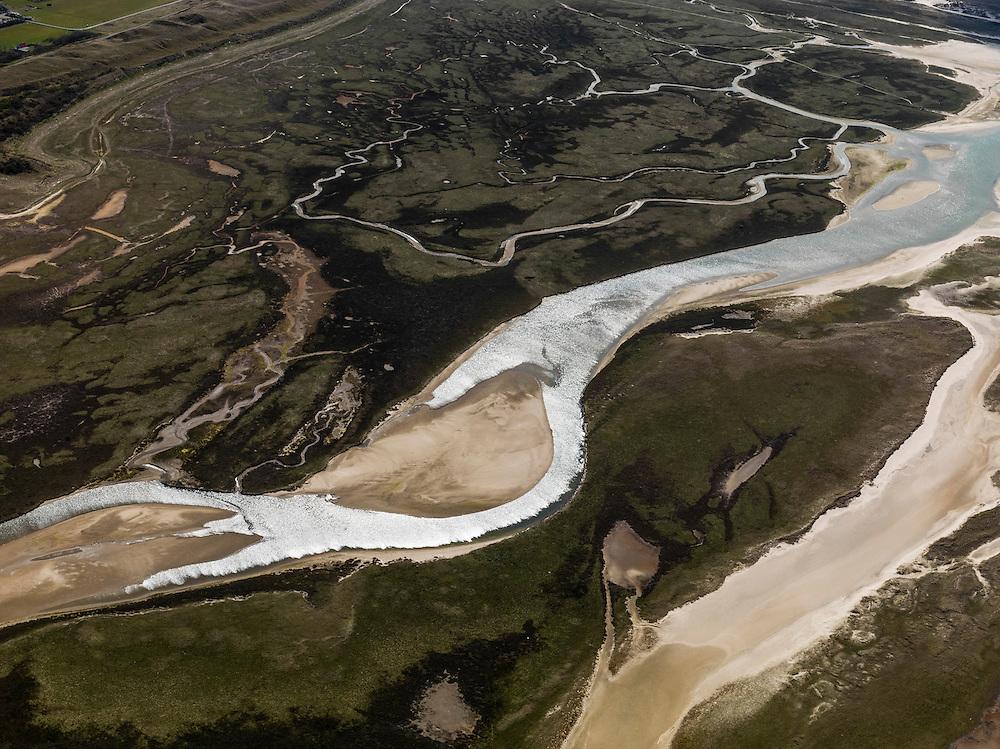 Nederland, Noord-Holland, Texel, 16-04-2012; Ingang van De Slufter, gezien vanaf de Noordzee.Het natuurgebied, een duinvalllei met kreken, is ontstaan doordat de duinen in het verleden doorgebroken zijn. De Sluftervallei staat in open verbinding met de Noordzee en wordt beïnvloed door eb en vloed. .Natural area The Slufter, beach and dunes of the isle of Texel. .luchtfoto (toeslag), aerial photo (additional fee required);.copyright foto/photo Siebe Swart.luchtfoto (toeslag), aerial photo (additional fee required);.copyright foto/photo Siebe Swart