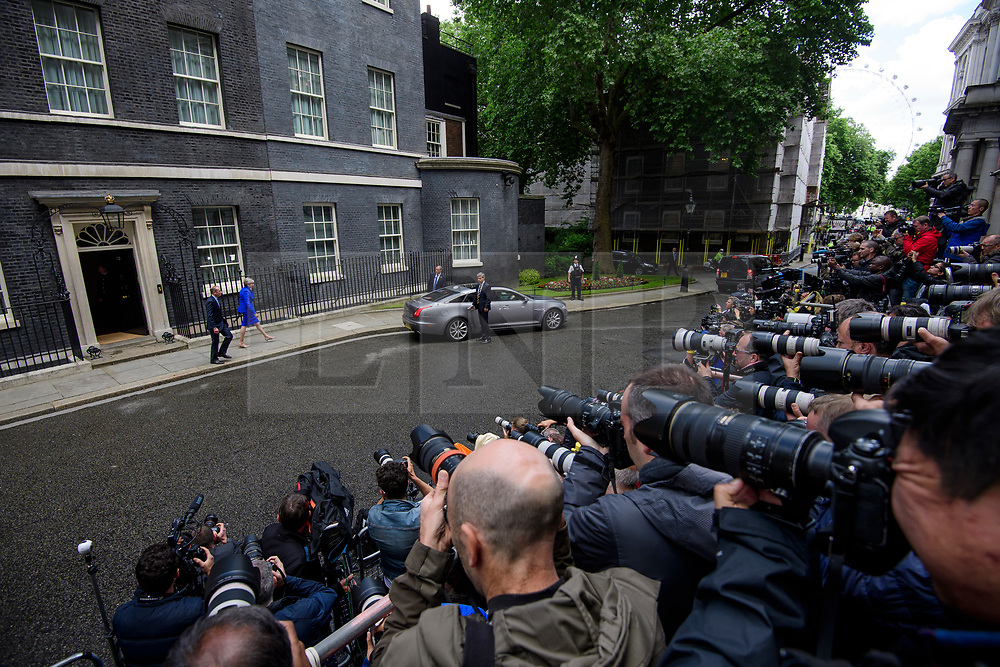 © Licensed to London News Pictures. 09/06/2017. London, UK. British prime minister  THERESA MAY leaves Downing Street with her husband PHILIP to meet with the Queen, the morning of the general election results in which the Conservative Party made substantial losses. Photo credit: Ben Cawthra/LNP