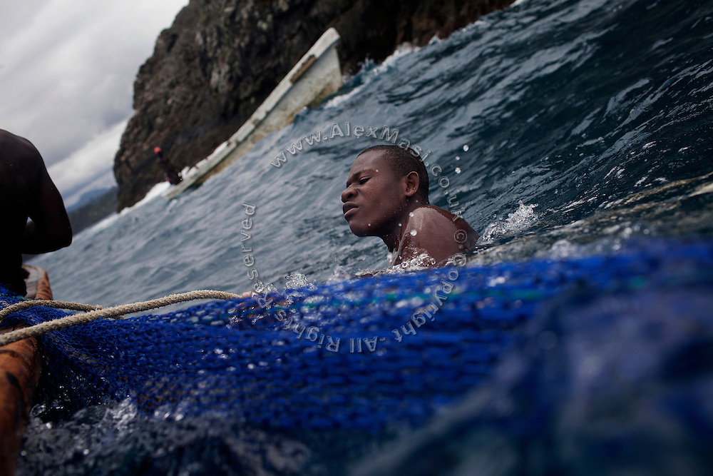 Fishermen are trying to catch a bank of fish near the island of Sao Tome, Sao Tome and Principe, (STP) a former Portuguese colony in the Gulf of Guinea, West Africa.