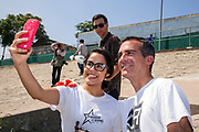 LA Mayor Eric Garcetti and Anaheim Mayor settle bet over LA Kings and Anaheim Ducks. Anaheim Mayor Tom Tait lost the bet and the two mayors spent two hours cleaning up the LA River along the Elysian Valley. Marsh Park, Los Angeles, California, USA. August 9, 2014