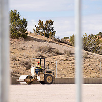 040513       Brian Leddy<br /> A worker with RMCI Inc compacts the field at the Gallup Sports Complex Friday. The park is currently undergoing a major renovation.