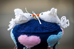 © Licensed to London News Pictures. 13/05/2018. Thirsk UK. Picture shows woollen Dove's with rings. The Thirsk Yarn bombers have decorated the town centre of Thirsk in North Yorkshire this morning with Prince Harry & Megan Markle wedding related woollen creations to celebrate the upcoming royal wedding at the weekend. Photo credit: Andrew McCaren/LNP