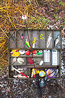 Tackle box and childs fishing pole.