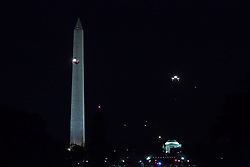 October 11, 2016 - Washington, DC, United States - Marine One carrying President Barack Obama comes in for a landing on the South Lawn of the White House October 11, 2106 in Washington, DC., with a nighttime view of the Washington Monument, and the Jefferson Memorial in the distance. (Credit Image: © Cheriss May/NurPhoto via ZUMA Press)