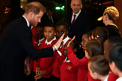 The Duke of Sussex high-fives a pupil from the Star Primary School Choir during the annual WellChild Awards at the Royal Lancaster Hotel, London.