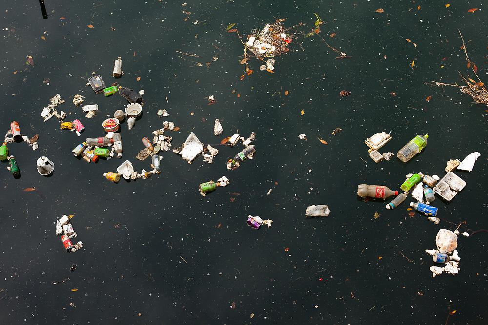 Shiodome Area, Shimbashi, Tokyo, Japan, Asia - Trash on a river in Shimbashi, Tokyo