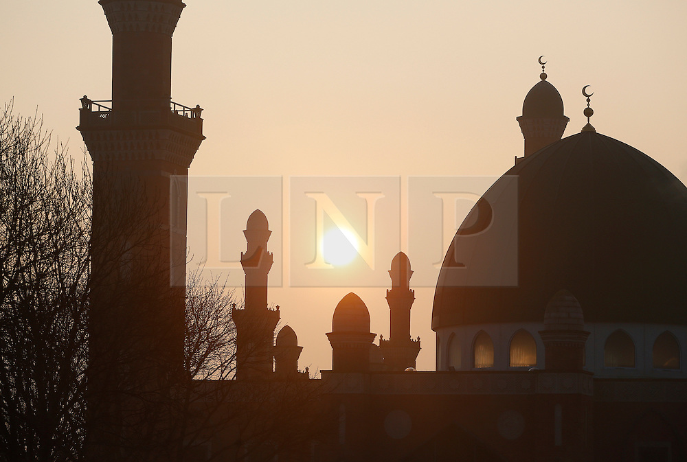 © Paul Thompson Licensed to London News Pictures. 18/03/2015.Bradford West Yorkshire. The Sun rising behind the Suffa Tul Islam Central Mosque in Horton Park Avenue, Bradford. The Mosque was funded by public subscription, and built over a period of ten years. Photo credit : Paul Thompson/LNP