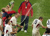 Photo. Steve Holland. England v Australia Final at the Telstra Stadium, Sydney. RWC 2003.<br />22/11/2003.<br />England team celebrated by spraying champange at Jonny Wilkinson Cup after winning the World Cup