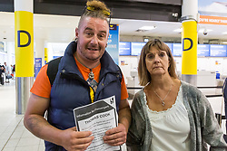 """Feeling """"abandoned"""", Felixstow couple James, 45 and Kim, 60, Edgerton-Stanbridge, who were bound for a Red Sea holiday in Egypt, at the Thomas Cook Check-in after the travel company ceased trading after failing to come to a deal with its bankers and creditors, leaving tens of thousands of travellers unable to depart on their holidays from South Terminal at Gatwick Airport, and a massive repatriation exercise to return holidaymakers from destinations all over the world. London Gatwick Airport, September 23 2019."""