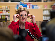 28 DECEMBER 2019 - URBANDALE, IOWA: US Senator ELIZABETH WARREN (D-MA), gestures to her glasses while she talks about changes in law that will allow pharmacists to sell some hearing aids over the counter. She pointed to her glasses to make the point that the law would allow hearing aids to be sold like glasses. Warren was at the pharmacy to announce that legislation she wrote will make hearing aids available over the counter. She said it should make hearing aids less expensive and increase competition in the hearing aid industry. The legislation was co-sponsored by Iowa Republican Senator Chuck Grassley and signed into law by President Trump. Warren is campaigning in Iowa this weekend to support her effort to be the Democratic nominee for the US presidential race in 2020. Iowa traditionally hosts the first presidential selection event of the campaign season. The Iowa caucuses are Feb. 3, 2020.         PHOTO BY JACK KURTZ