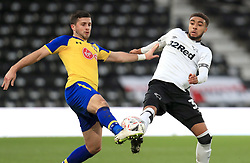 Southampton's Shane Long (left) and Derby County's Jayden Bogle battle for the ball during the Emirates FA Cup, third round match at Pride Park, Derby.