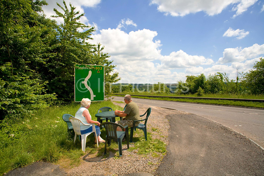 Lunch with a view, a couple enjoy a break from the road at a roadside burger van on the 7th June 2008 in Winterbourne Stoke in the United Kingdom. Winterbourne Stoke is in Wiltshire, along the busy A303 trunk road.