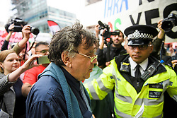 © Licensed to London News Pictures. 04/09/2018. London, UK. Leftwing activist PETER WILLSMAN surrounded by media and police as he arrives at Labour Party headquarters in London to attend a National Executive Committee meeting. The Labour Party's ruling body is expected to vote on whether to adopt, in full, the IHRA (International Holocaust Remembrance Alliance) definition of anti-Semitism. Photo credit: Ben Cawthra/LNP
