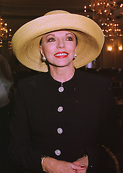 Actress JOAN COLLINS at a party in London on 12th June 1998.MIH 12