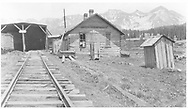 """Lizard Head RGS section house and wye snowshed portal.  Note sign """"Lizard Head Elev. 10,500"""".<br /> RGS  Lizard Head, CO  ca. ? 1951<br /> Also at RDS079-004.<br /> Thanks to Don Bergman for additional information."""