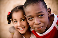 Oman, Al-Hamra. Children from Al-Hamra. Their skin are a little bit darker, because probably their ancestors were the African traders who had settled in Oman.
