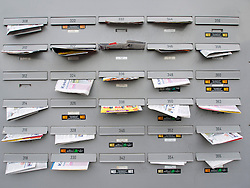 Apartment building letterboxes full of junk mail in Amsterdam The Netherlands