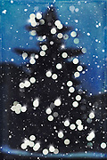 Christmas tree silhouette with lights and falling snow