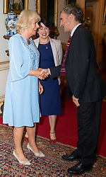 Her Royal Highness Camilla the Duchess of Cornwall hosts a reception at Clarence House to mark the tenth anniversary of First story, an initiative to encourage writing in especially among those from deprived backgrounds in schools across the country PICTURED: Camilla meets co-founder of First Story William Fiennes . London, July 10 2018.